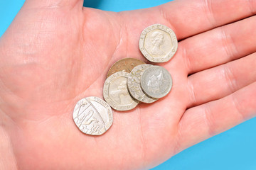 Pounds pennies coins on a palm of a man hand