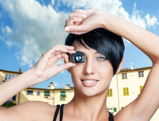 Beautiful woman with toy small camera