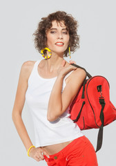 Stylish young woman with red bag