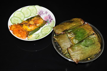 delicious glutinous rice wrap in banana leaves with chilies