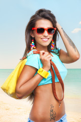 Stylish young woman on sea beach