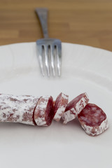 salami party and fork