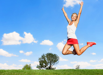 Sporty woman jumping high in air