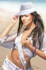 Beautiful woman posing on beach