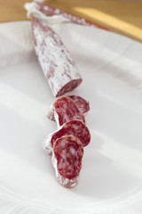 plate with slices of salami