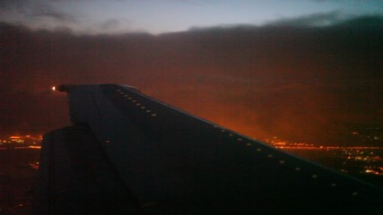 view illumination of the night city from an aircraft window