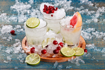 set of ice cocktails with berries and fruits