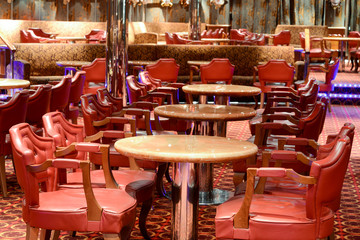 Red leather chairs and tables