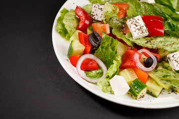 greek vegetable salad with cucumbers, onions herbs cheese