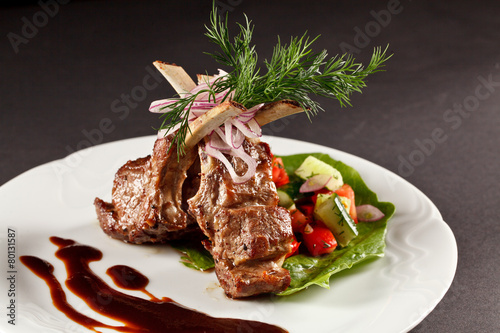 Plexiglas Assortiment rack of lamb with vegetables and sauce