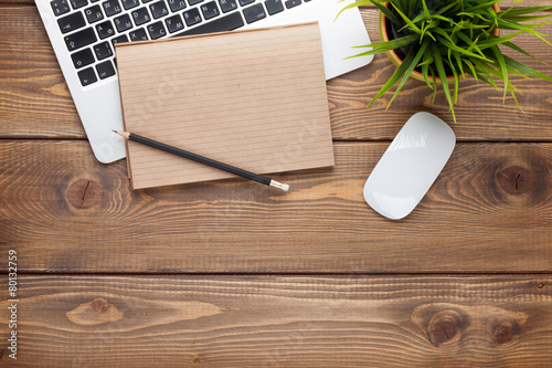 Office desk table with computer, supplies and flower - 80132759