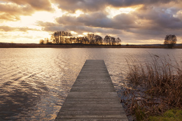 Sunset over jetty on the Elbe river