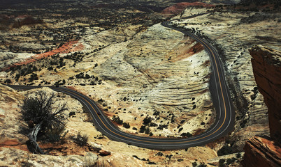 View from above of a winding road through the Utah desert landscape.