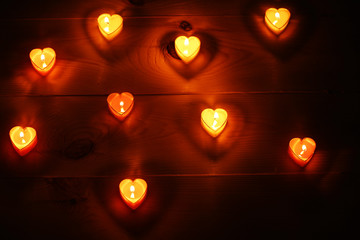 Romantic atmosphere with candle lights on dark background