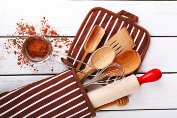 Set of kitchen utensils with cocoa in mitten
