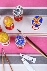 Painting Easter eggs on table close up