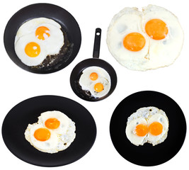 set from two fried eggs isolated on white