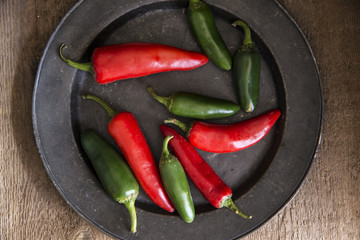 Red and green peppers in vintage retro moody natural lighting se