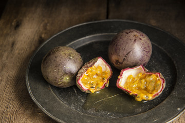 Passion fruit in moody natural light setting with vintage retro