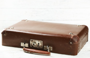 Old wooden suitcase cap on wooden background