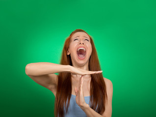 woman showing time out hand gesture, frustrated screaming