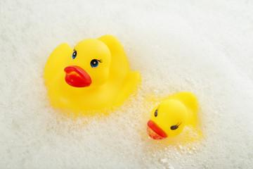Rubber ducks in foam close-up