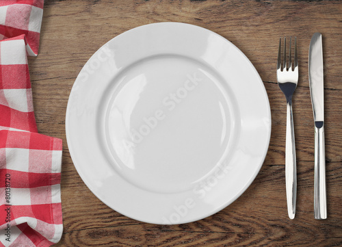 dinner table with dinning plate, fork and knife top view - 80138720