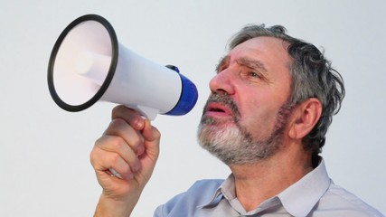 Senior man with beard speaks in megaphone, closeup