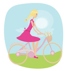 Girl is riding bike on spring field.
