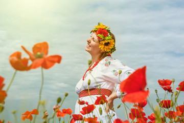 Happy smiling ukrainian woman among blossom field