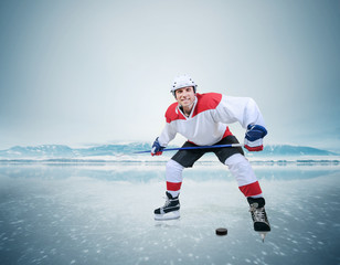 Hockey player on the ice surface of lake
