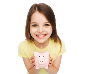 beautiful little girl with piggy bank
