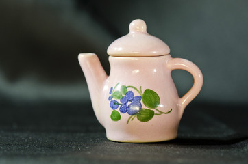small ceramic pot with pink flowers violets