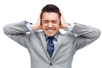 businessman in suit having head ache