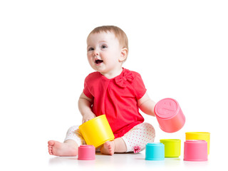 funny baby playing with colourful cup toys, isolated over white
