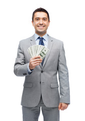 smiling businessman with american dollar money