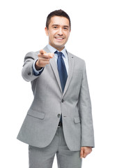 happy smiling businessman in suit pointing at you
