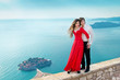 Young couple embraccing over the sea on romantic travel honeymoo