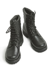 Black leather army boots on a white background