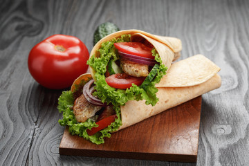 pair of fresh juicy tortilla wraps with chicken and vegetables