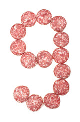 Number 9 arranged from salami sausage slices isolated