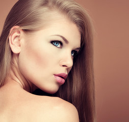 Hair extension and styling. Young model with long straight hair