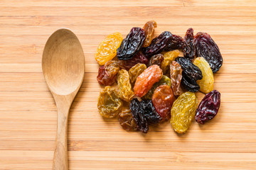 Dried raisins on the wood with spoon