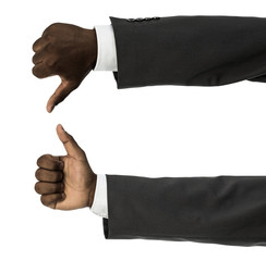 African descent man doing thumbs up and down gesture