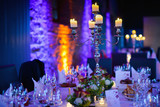 Elegant candlelight dinner table by night - 80145398