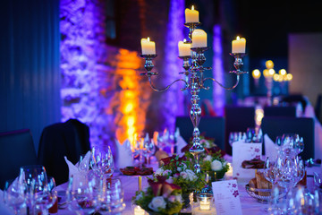Elegant candlelight dinner table by night