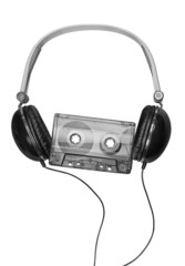 90s. Compact headphones with audio cassette on white background