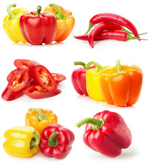 collection of red and yellow peppers isolated on the white backg