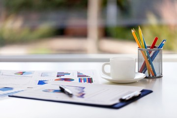 Desk. Close-up image of an office desk at morning with a cup of