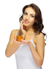Young healthy girl with body cream